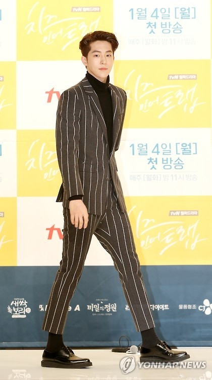"South Korean actor Nam Ju-hyuk walks onto the stage at the press briefing for ""Cheese in the Trap"" on December 22, 2016. (Yonhap)"