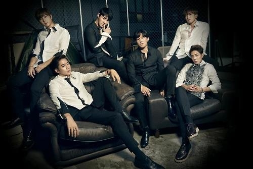 Shinhwa members pose for a photo in this image provided by Shinhwa Company. (Yonhap)