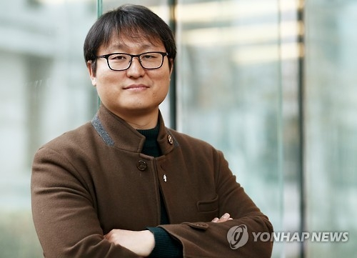 Director Cho Jung-rae poses for a photo ahead of an interview with Yonhap News Agency. (Yonhap)
