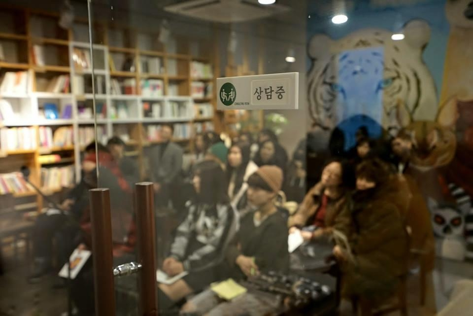 This photo provided by Cafe Doing shows visitors at its opening ceremony in Seoul on Feb. 4, 2017. (Yonhap)