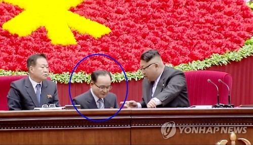 This image captured from footage of North Korea's state-run TV broadcaster on Dec. 25, 2016, shows Jo Yong-won (C), an official in the ruling Workers' Party of Korea, who listened to instruction by North Korean leader Kim Jong-un (R) at a party event in Pyongyang. Jo is a deputy director of the Organization & Guidance Department under the ruling party. (For Use Only in the Republic of Korea. No Redistribution) (Yonhap)