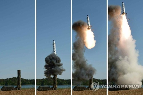 A set of photos carried by North Korea's main newspaper, the Rodong Sinmun, on May 22, 2017, shows the test-firing of a new intermediate-range ballistic missile, known as the Pukguksong-2, in North Korea. (For Use Only in the Republic of Korea. No Redistribution) (Yonhap)
