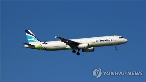 Air Busan A321 passenger jet approaching an airport. (Yonhap)
