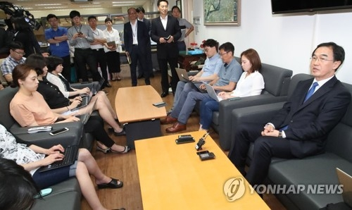 This photo taken on July 3, 2017, shows new Unification Minister Cho Myoung-gyon (R) speaking to reporters after taking office. (Yonhap)