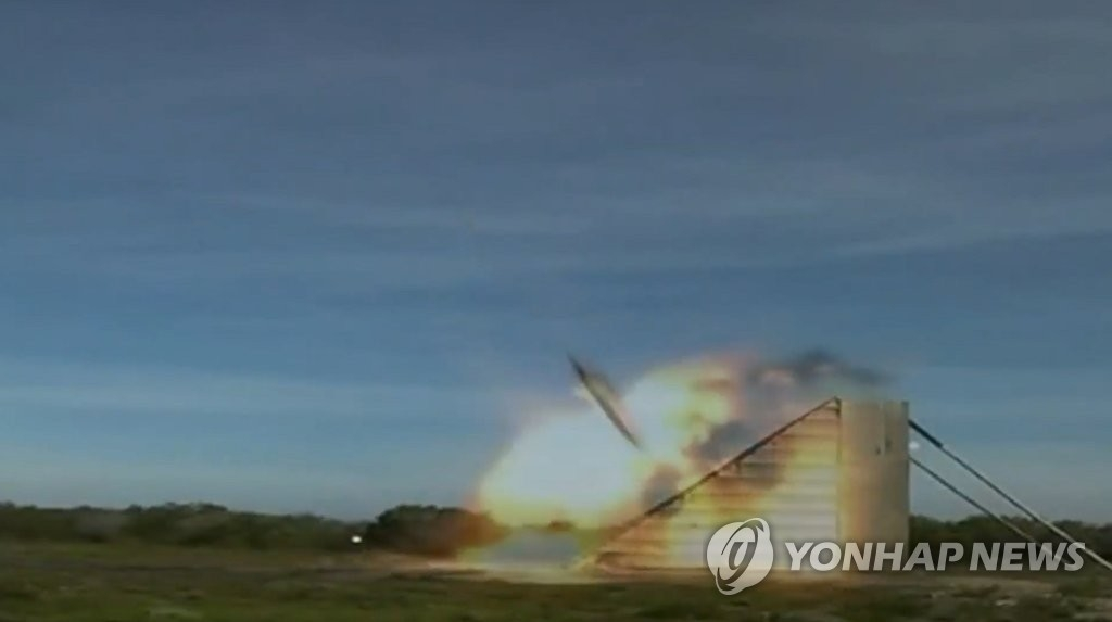 A Taurus missile hits a target in a test launch in this photo provided by South Korea's military. (Yonhap)