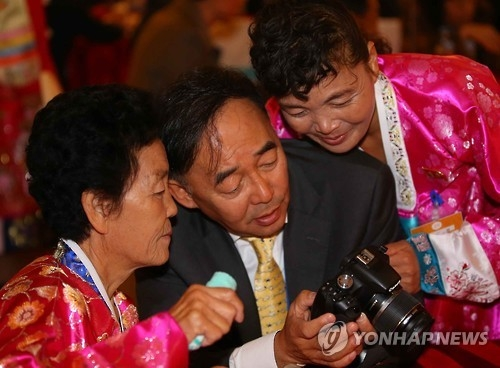 This file photo taken on Oct. 26, 2015, shows South and North Koreans taking part in family reunions for those separated by the 1950-53 Korean War at a hotel on Mount Kumgang in the North. (Yonhap)