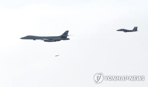 A U.S. B-1B bomber drops an inert bomb on a mock target during its joint drill with South Korea's fighter jets on July 8, 2017, in this photo provided by the Air Force. (Yonhap)