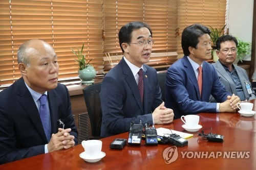 This photo taken on July 12, 2017, shows Unification Minister Cho Myoung-gyon (C) speaking at the start of a meeting with officials from local firms that ran factories at the now-shuttered Kaesong Industrial Complex. (Yonhap)