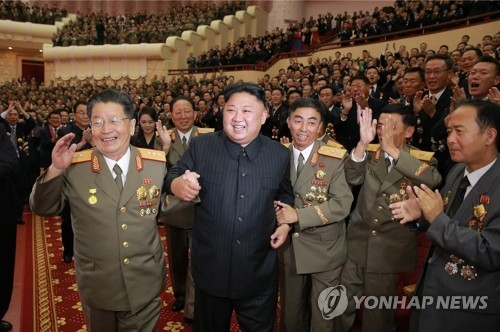 This file photo, released by the Korean Central News Agency on Sept. 10, 2017, shows North Korean leader Kim Jong-un holding hands with other ranking officials at a banquet in celebration of its latest nuclear test conducted on Sept. 3. (For Use Only in the Republic of Korea. No Redistribution) (Yonhap)