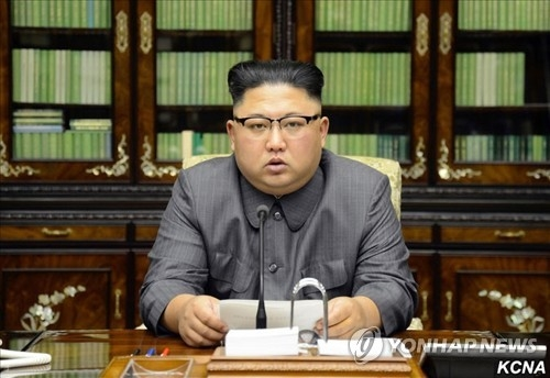 "This photo carried by North Korea's state news agency on Sept. 22, 2017 shows North Korean leader Kim Jong-un reading his statement condemning U.S. President Donald Trump for threatening to ""totally destroy"" the North. (For Use Only in the Republic of Korea. No Redistribution) (Yonhap)"