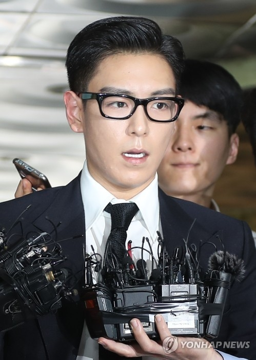 In this file photo, T.O.P of popular K-pop group BIGBANG, speaks to reporters as he walks into the courthouse for a trial on his illegal drug use in Seoul, on July 20, 2017. He was given a 10-month jail term with a two-year suspension. (Yonhap)