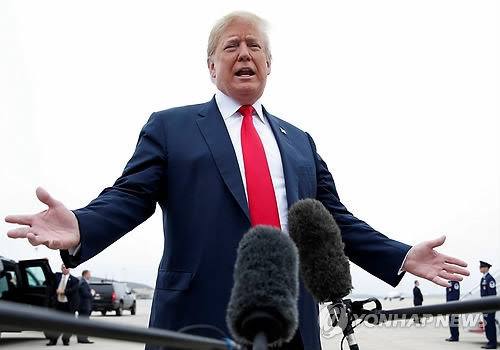 This Reuters photo shows U.S. President Donald Trump speaking to reporters at Joint Base Andrews, near Washington, on May 31, 2018. (Yonhap)