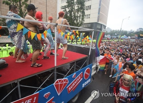 Participants in the 2017 Korea Queer Festival stage a street parade in downtown Seoul on July 15, 2017. (Yonhap)