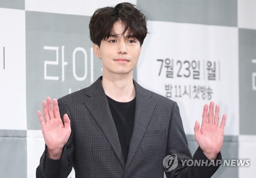 "Actor Lee Dong-wook, who plays the role of Ye Jin-woo in the new TV series ""Life,"" poses for photos during a press conference in southern Seoul on July 23, 2018. (Yonhap)"