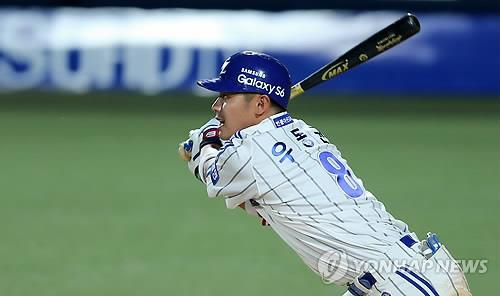 In this file photo from May 1, 2015, Woo Dong-gyun of the Samsung Lions hits a double against the Doosan Bears in the bottom of the third inning of a Korea Baseball Organization regular season game at Daegu Citizen Stadium in Daegu, 300 kilometers southeast of Seoul. (Yonhap)