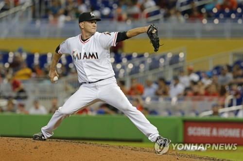 In this Associated Press file photo from Sept. 23, 2018, Drew Rucinski, then with the Miami Marlins, throws a pitch against the Cincinnati Reds in the top of the ninth inning of a Major League Baseball regular season game at Marlins Park in Miami. Rucinski will pitch for the NC Dinos in the Korea Baseball Organization in 2019. (Yonhap)