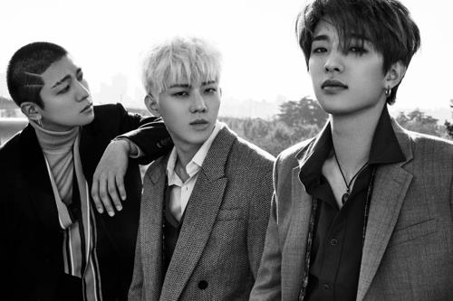 This image of DAY6 members -- Sungjin (L), Dowoon (C) and Jae -- was provided by JYP Entertainment. (Yonhap)