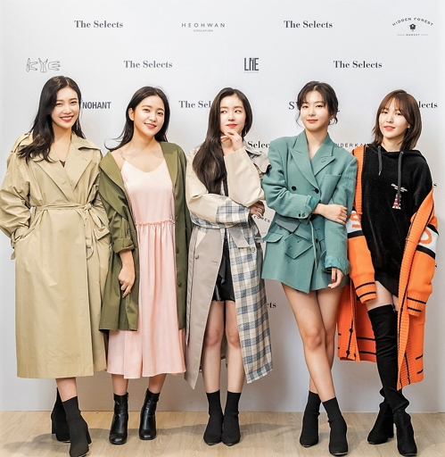 In this photo provided by the Korea Creative Content Agency, Red Velvet members pose for photographers wearing fashion items they designed in collaboration with five Korean designer brands. (Yonhap)
