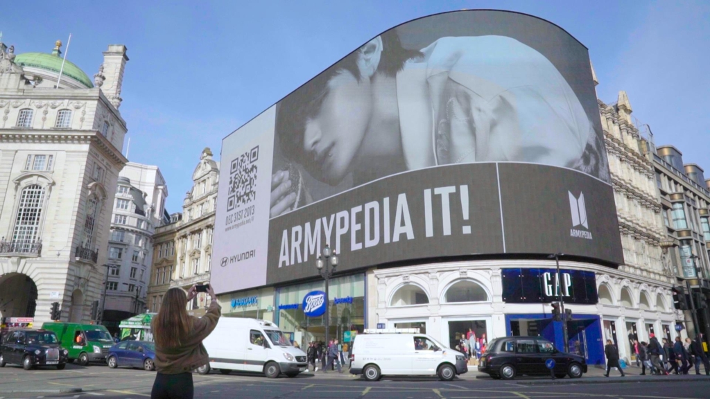 BTS' teaser video for its new website plays in London's Piccadilly Circus on Feb. 22, 2019. (Yonhap)