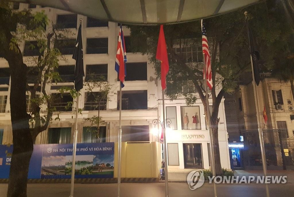 The national flags of North Korea, the United States and Vietnam are flown in front of Sofitel Legend Metropole Hotel in Hanoi on Feb. 26, 2019. (Yonhap)