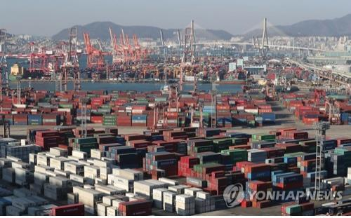 This undated photo shows containers carrying goods for export stacked on the piers of South Korea's largest port city of Busan. (Yonhap)