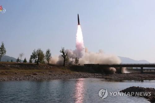 "This photo, captured from Pyongyang's Korean Central TV on May 10, 2019, shows a missile launch carried out during a strike drill ""in the forefront area and on the western front"" under the guidance of North Korean leader Kim Jong-un the previous day. (For Use Only in the Republic of Korea. No Redistribution) (Yonhap)"