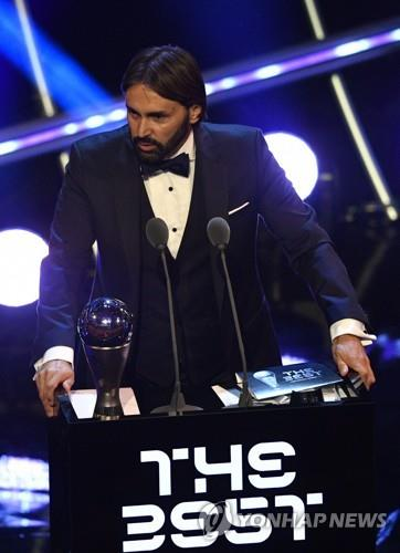 In this EPA file photo from Sept. 24, 2018, Reynald Pedros gives an acceptance speech after receiving the Best FIFA Women's Coach Award during a ceremony in London. (Yonhap)