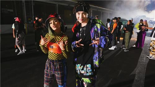 "This image of J-Hope (R) and Becky G from a scene of the ""Chicken Noodle Soup"" music video was provided by Big Hit Entertainment. (PHOTO NOT FOR SALE) (Yonhap)"