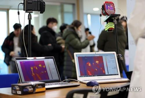 Thermal cameras are installed at the entrance of Jangchung Arena in Seoul on Feb. 5, 2020, as South Korea confirmed four more cases of the novel coronavirus, bringing the total here to 23. (Yonhap)