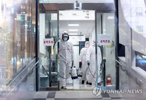 S. Korea ups anti-virus fight in Daegu and neighboring region as cases near 1,000