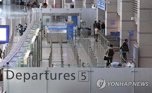 Incheon International Airport, west of Seoul, is almost empty on March 13, 2020, as South Korea struggles to contain the spread of COVID-19. (Yonhap)