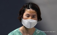 S. Korea braces for long virus fight as total cases top 10,000