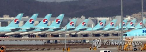 This file photo shows grounded Korean Air passenger jets at Incheon International Airport, west of Seoul. (Yonhap)