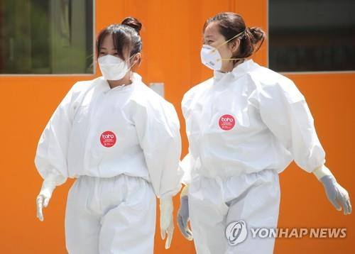 (Yonhap Feature) Medical workers' courage and sacrifice most appreciated in S. Korea's virus fight