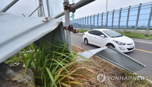 A construction site fence destroyed by strong winds is seen on a road on Jeju Island on June 30, 2020. (Yonhap)