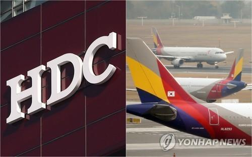 HDC's company logo and Asiana Airlines' planes at an airport in South Korea (Yonhap)