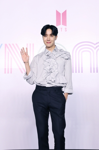 """J-Hope of K-pop sensation BTS poses for photos during an online press conference for the new single """"Dynamite"""" held in Seoul on Aug. 21, 2020, in this photo provided by Big Hit Entertainment. (PHOTO NOT FOR SALE) (Yonhap)"""