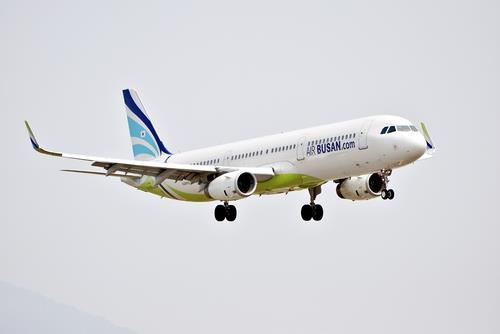 This undated file photo provided by Air Busan shows an A321-200 flying in the sky. (PHOTO NOT FOR SALE) (Yonhap)