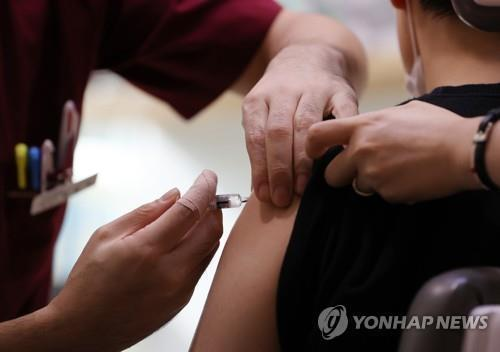This undated file photo shows a flu shot being administered. (Yonhap)