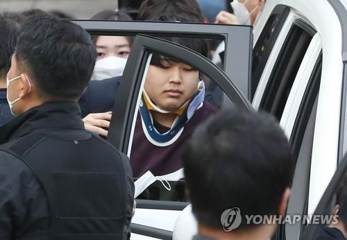 The file photo taken March 25, 2020, shows Cho Ju-bin being taken into a car at a police station in Seoul. (Yonhap)
