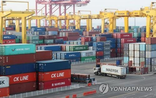 This file photo shows stacks of import-export cargo containers at a port in Incheon, west of Seoul. (Yonhap)