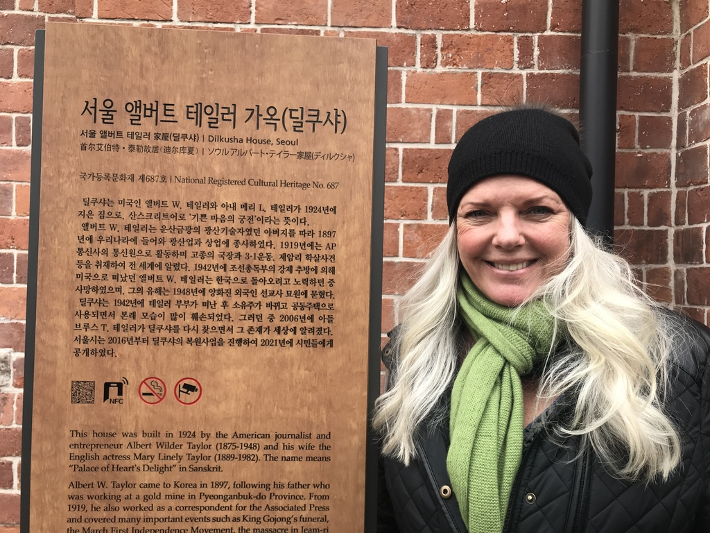 Jennifer Taylor, the granddaughter of Albert and Mary Taylor, poses in front of Dilkusha on Feb. 25, 2021. (Yonhap)