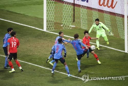 In this file photo from Dec. 18, 2019, South Korea (in red tops) and Japan are in action in the final of the East Asian Football Federation (EAFF) E-1 Football Championship at Busan Asiad Main Stadium in Busan, 450 kilometers southeast of Seoul. (Yonhap)
