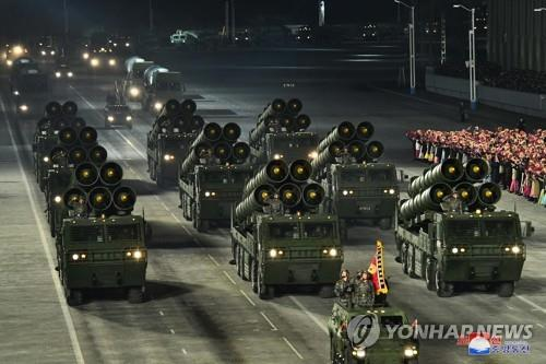 This photo, released by North Korea's official Korean Central News Agency on Jan. 15, 2021, shows vehicles carrying multiple rocket launchers during in a military parade at Kim Il-sung Square in Pyongyang the previous day to celebrate the recently concluded eighth congress of the North's ruling Workers' Party. (For Use Only in the Republic of Korea. No Redistribution) (Yonhap)