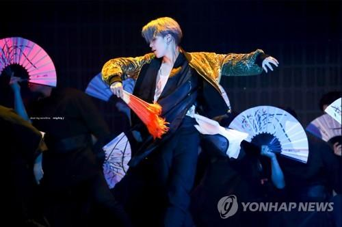 "This captured image on Twitter shows BTS member Jimin dancing in ""hanbok,"" traditional Korean attire, during a local music awards show in Jeonju, about 240 kilometers southwest of Seoul, on Dec. 4, 2018. (PHOTO NOT FOR SALE) (Yonhap)"