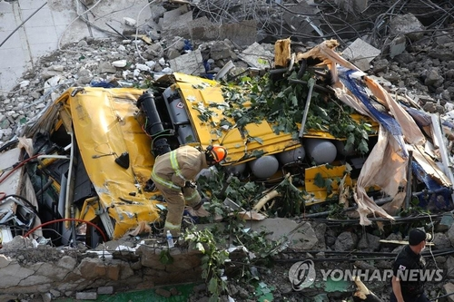 A firefighter checks the site of an accident in the southwestern city of Gwangju on June 9, 2021. (Yonhap)