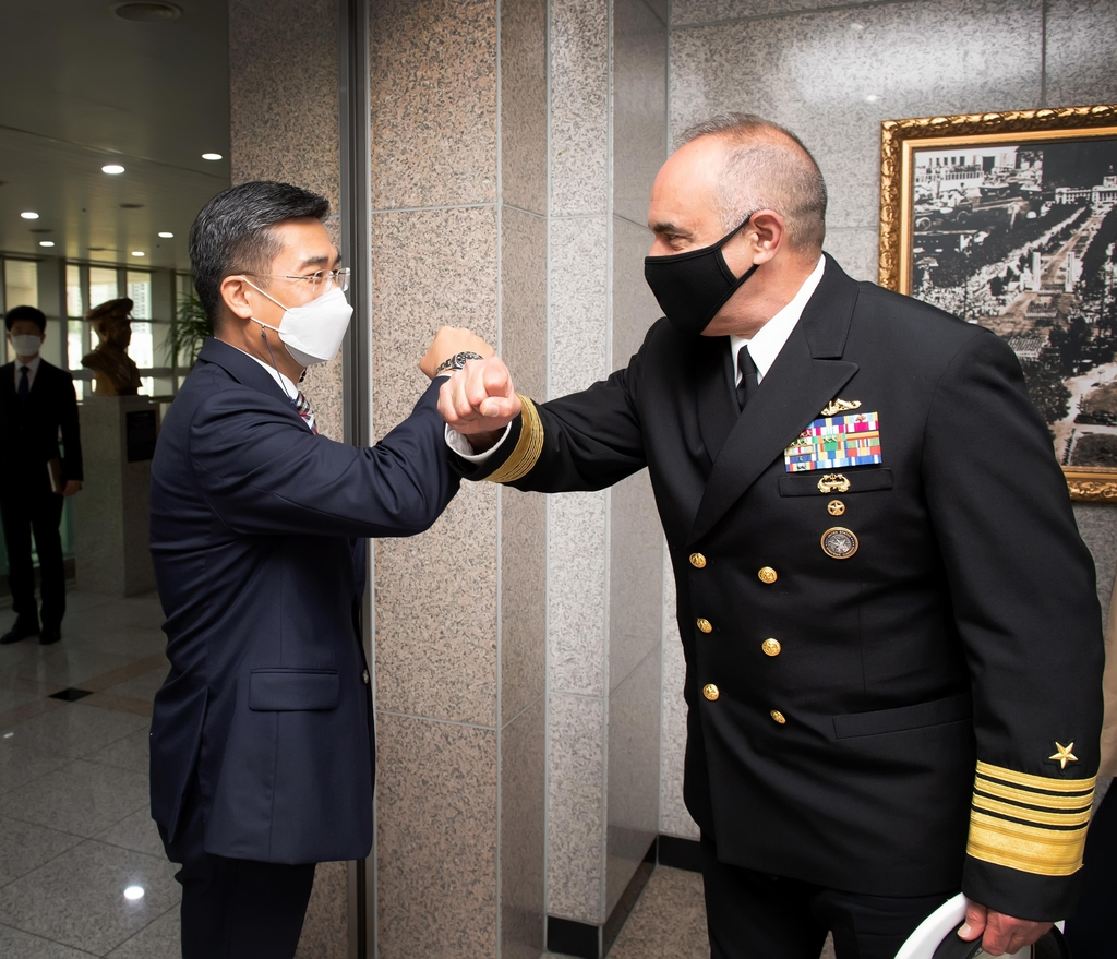 Defense Minister Suh Wook (L) greets Adm. Charles Richard, commander of the U.S. Strategic Command, in Seoul on July 14, 2021, in this photo provided by the defense ministry. (PHOTO NOT FOR SALE) (Yonhap)