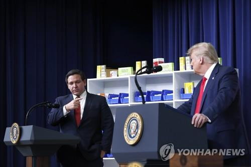 드샌티스 주지사(왼쪽)과 트럼프 전 대통령