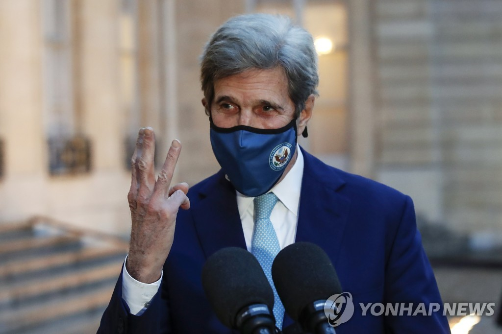 This file photo, released on March 10, 2021 by the Associated Press, shows U.S. Special Presidential Envoy for Climate John Kerry gesturing as he speaks to the media after a meeting with French President Emmanuel Macron at the Elysee Palace in Paris. (Yonhap)