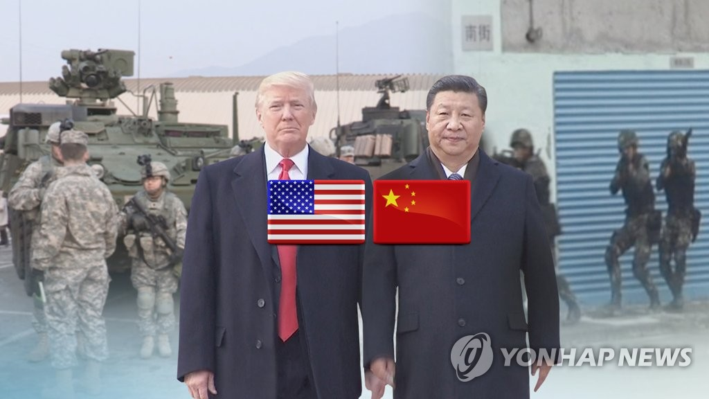 This image, provided by Yonhap News TV, shows U.S. President Donald Trump (L) and Chinese President Xi Jinping. (Yonhap)